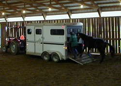 Students work on trailer loading at Meredith Manor's horse training schools.